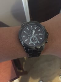 round Invicta chronograph watch with link bracelet