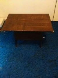 Table with storage compartment