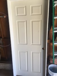 New 6 panel wood door with hinges and casing