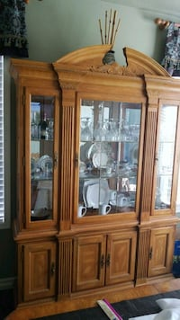 brown wooden framed glass display cabinet North Las Vegas, 89031