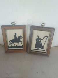 two brown wooden framed stitch work Arlington