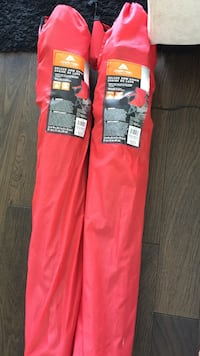 Two red Ozark Trail camping chairs only 5 months old used a few times
