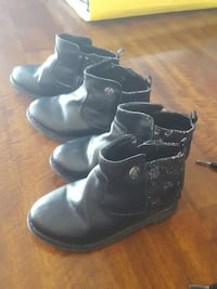 toddler's two pairs of black leather booties