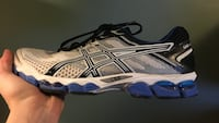 white-and-blue ASICS running shoe