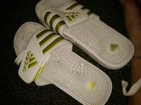 pair of white Adidas slide sandals Anderson, 96007