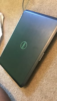 black and green HP laptop