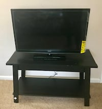 Black flat screen tv with wooden tv stand