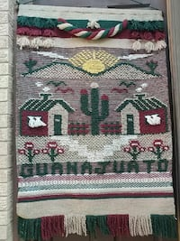 green, beige, and red crosstitch artwork Pharr, 78577