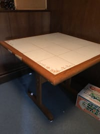 """Tile top trestle style table. 34""""x34""""x28.5"""" high. Adjustable levelers on bottom. Excellent condition   Wallingford, 06492"""