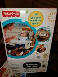 Brand new Fisher Price Baby Space Saver High Chair.