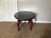 Round brown wooden side table Virginia Beach, 23455