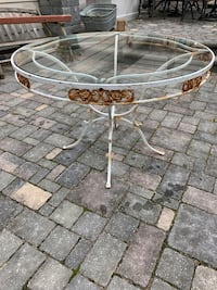 Outdoor wrought iron antiqued glass table