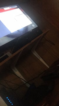 black and gray TV stand 70 km