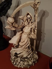 Grim reaper carved in real whale bone