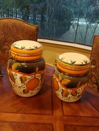 Ceramic canisters, approx 8 in and 9 in tall Spring, 77386