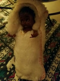 ANTIQUE BLACK BABY DOLL!! IN WHITE SLEEPING