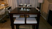 rectangular brown wooden table with six chairs din Las Vegas, 89117