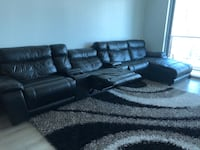 Leather black reclining sofa with glass portable in between. Great! Miami, 33130