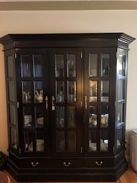 brown wooden framed glass display cabinet Calgary, T3E 3L4