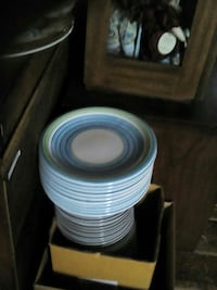 round teal and white ceramic plates