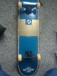blue and white skateboard deck 550 mi