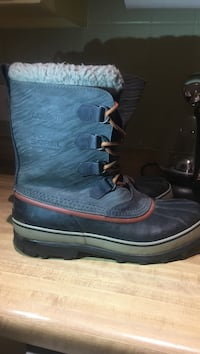 pair of black Sorel leather duck boots