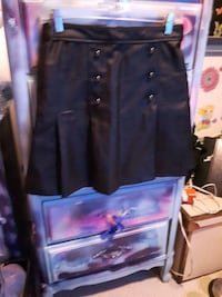 Woman's new black leather skirt. Vancouver, V6A 1P4