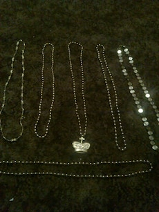 six silver necklaces