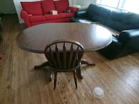 round brown wooden pedestal table with two chairs London, N6G 1T9