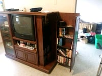 brown wooden TV hutch with flat screen television Knoxville, 37917