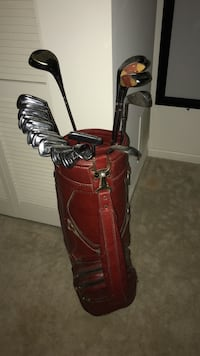 Red and black golf bag with golf clubs. Great for decoration in your man cave, or you can even use as your normal set. Comes with full ben hogan set.  Sand wedge through driver Laurel, 20724