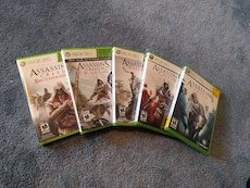 five \Assassin's Creed XBOX 360 game cases