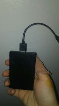 Portable charger with micro USB cable  Houston, 77077
