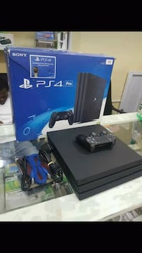 black Sony PS4 console with controller and box New York