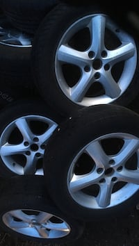 Gray 5-spoke car wheel with tire set Nanaimo, V9T 6T2