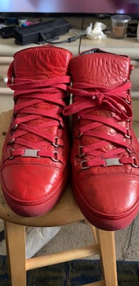 Pair of red high top Balenciagas