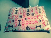 white and black paw and bone print bed pillow never been used