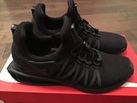 pair of black Nike running shoes Maple Ridge, V2X