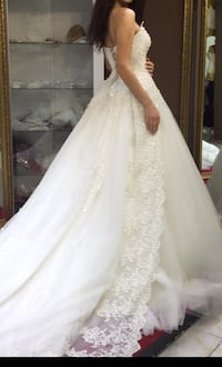 Women's white lace strapless wedding gown