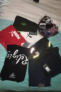 A bunch of name brand clothing