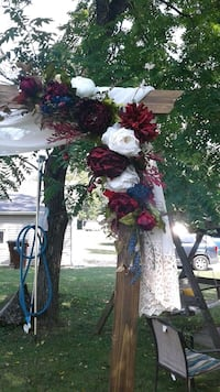 Dark stained wooden arbor and flowers. Antiques cloth sold seperate.