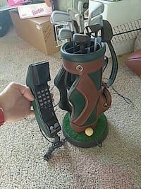 brown and green corded golf bag designed telephone