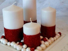 four white pillar candles