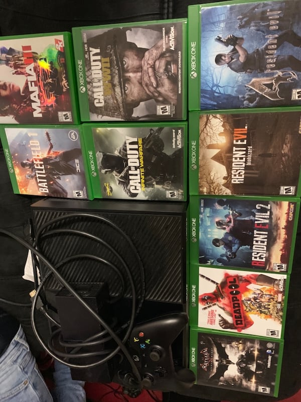 Xbox one with games 70c8e240-659f-4591-9917-30c3154dd6c6
