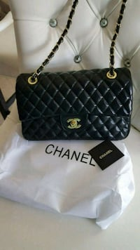 black and white Chanel leather shoulder bag Mississauga, L5T 2L8