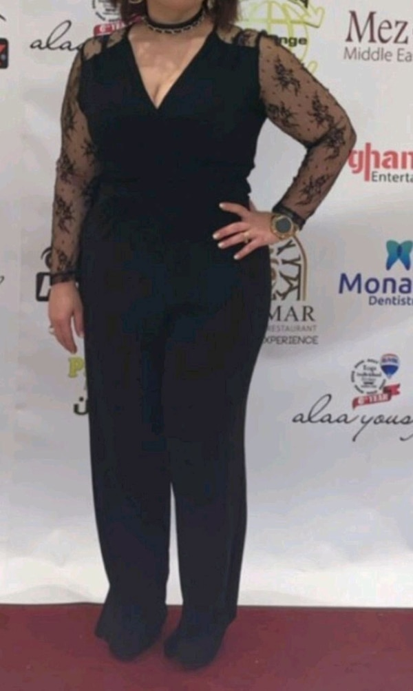 black jumpsuit/streagie size 10/14 in perfect condition