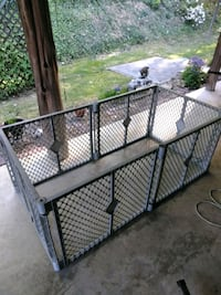 Dog play pen with doggie door
