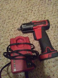 red and black corded power drill