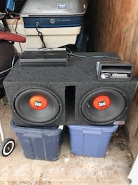 black-and-red Dual double loaded subwoofer with enclosure