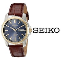 round gold-colored analog watch with brown leather strap Toronto, M6S 2T7